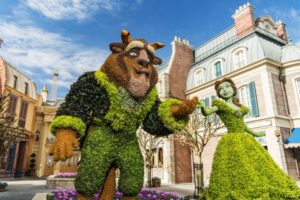 """A new Belle topiary, based on the Disney animated classic, """"Beauty and the Beast,"""" graces the entrance of the France Pavilion at the 2017 Epcot International Flower & Garden Festival. Topiary artists have found new ways to use a wider variety of plant materials to represent character topiary facial features, bringing Belle's face to life. The festival, which runs 90 days March 1-May 29, 2017 at Walt Disney World Resort in Lake Buena Vista, Fla., features dozens of character topiaries, stunning floral displays, gardening seminars and the Garden Rocks concert series -- all included in regular Epcot admission. (Matt Stroshane, photographer)"""