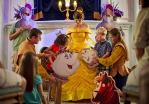 """Each portraying a character from the Disney animated classic """"Beauty and the Beast,"""" Magic Kingdom guests join Belle and Lumiere in a fun-filled storytelling adventure at Enchanted Tales with Belle. The interactive character experience is part of New Fantasyland at Walt Disney World Resort in Lake Buena Vista, Fla. (Kent Phillips, photographer)"""