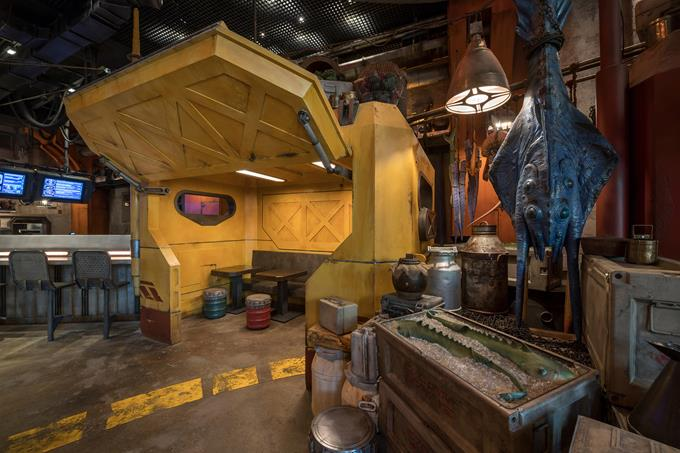 """Guests will discover innovative and creative food and drink from around the galaxy at Star Wars: Galaxy's Edge at Disneyland Park in California and opening Aug. 29, 2019, at Disney's Hollywood Studios in Florida. Docking Bay 7 Food and Cargo is a designated location for traveling food shuttles. Chef Strono """"Cookie"""" Tuggs is in much demand for his culinary skills, so he moves from site to site in a modified Sienar-Chall Utilipede-Transport that becomes a mobile kitchen and restaurant. (Kent Phillips, photographer)"""